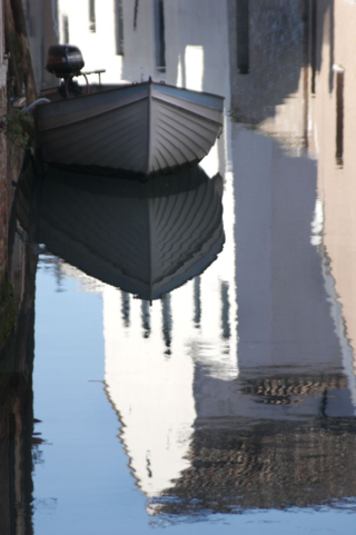 white boat in the canal